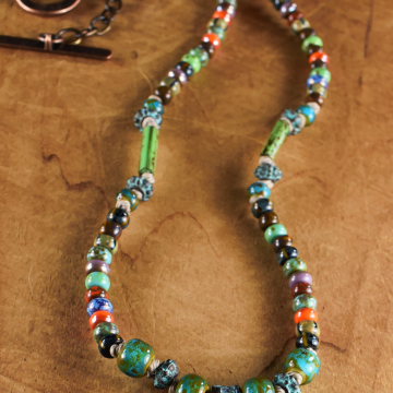 Czech glass and Mykonos pewter in a beaded necklace by Gloria Ewing.