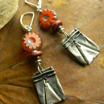 Bohemian pewter charms with orange flowers by Gloria Ewing.