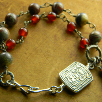 Rosary style beaded bracelet by Gloria Ewing.