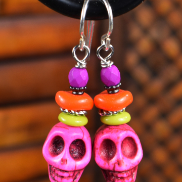 Pink beaded skull earrings for Halloween by Gloria Ewing.