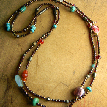 Tiny knotted beads in a long elegant design by Gloria Ewing.