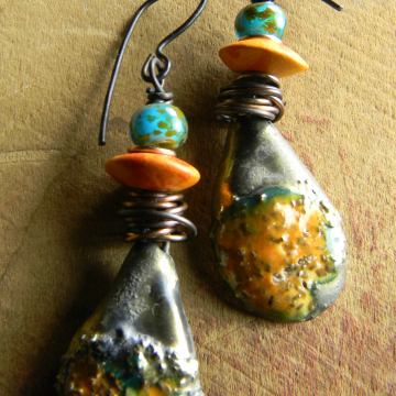 Ceramic and Czech glass earrings with copper wire wrap by Gloria Ewing.